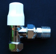 Photo of a lockshield radiator valve. A lockshield radiator valve is a manual valve.
