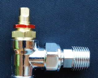 Photo showing the gland nut on a manual radiator valve