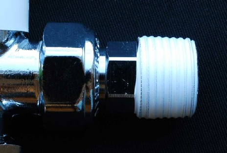 Photo showing PTFE tape smoothly bedded in on the threaded tail of a radiator valve prior to fitting to the radiator